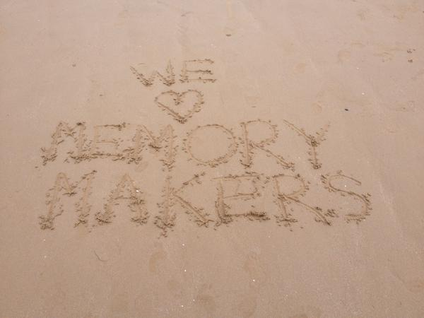 'We love Memory Makers' written in sand at the beach